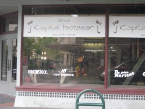 This is Capital Footwear, because it is located in the state's capital, Olympia. It is on Capitol Street, because the capitol building is at the end of the street.